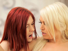 Blonde and redhead pleasuring steaming hot lesbian sex
